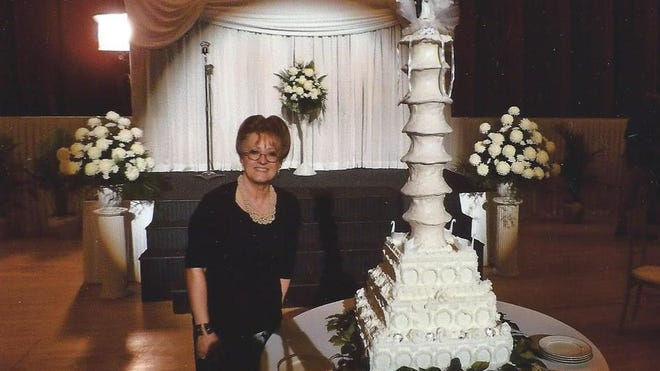"""Faye Fair poses with the replica wedding cake she made for """"I Saw the Light."""""""
