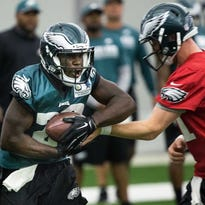 Carson Wentz hands off to Wendell Smallwood last month.