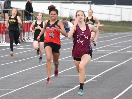 Stuarts Draft's Jordan Ramsey leads Riverheads' Jordan Jones down the home stretch of the girls 200-meter dash during a track meet with Buffalo Gap on Wednesday, April 18, 2018, at Riverheads High School in Greenville, Va.