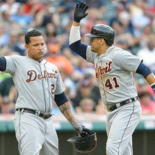 Miguel Cabrera celebrates with Victor Martinez of the Detroit Tigers after both scored on a home run hit by Martinez during the third inning against the Cleveland Indians.