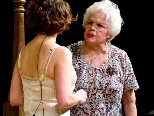 "Michelle Jorgensen and Kitty Lynne Klich, as Maggie and Big Mama, share a tense moment in STC's production of ""Cat on a Hot Tin Roof"" for its 83rd season."