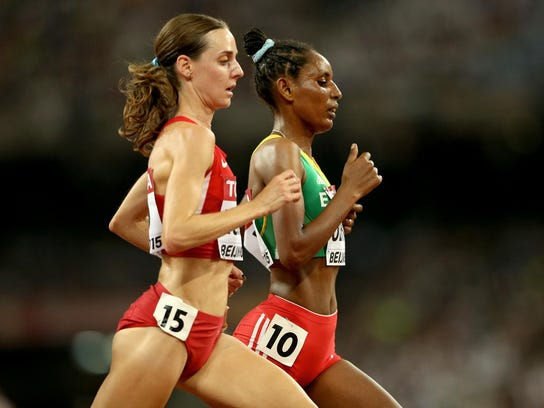 Molly Huddle, left, Belaynesh Oljira of Ethiopia compete