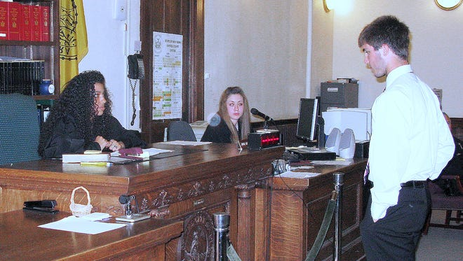 Elmira Youth Court members conduct a mock trial in this 2009 photo.