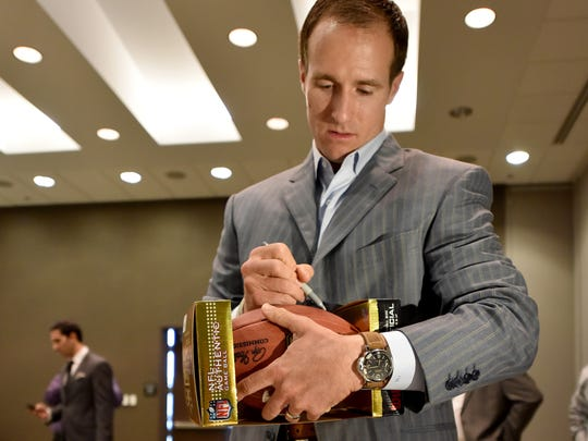 New Orleans Saints Quarterback Drew Brees signs autographs on items from helmets to footballs and jerseys last June at the first annual Best of Mississippi Preps at the Jackson Convention Complex in Jackson.