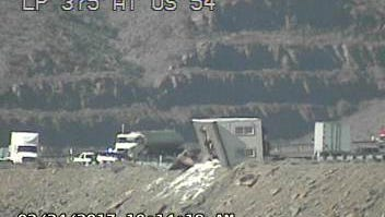 A semi-truck carrying a mobile home rolled over Loop 375 Friday morning.