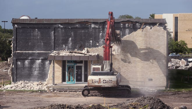 Demolition begins on the English building at Del Mar College's East campus on Friday, June 23, 2017. Demolition of the building is expected to last about two weeks.