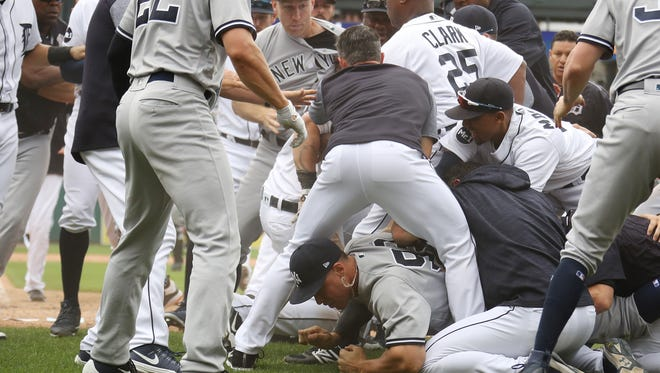 Yankees rightfielder Aaron Judge lays on the ground during a bench clearing fight in the sixth inning of the Tigers' 10-6 win on Thursday, Aug. 24, 2017, at Comerica Park.
