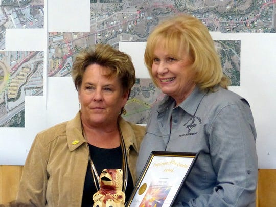 Nancy Smith, records secretary for the Ruidoso police, received the award for administrative employee of the quarter from Debi Lee Lee