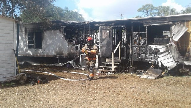 A mobile home in Twin Pines Village was destroyed in a fire Tuesday. A resident escaped unhurt but her dog was killed.