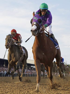 California Chrome, ridden by jockey Victor Espinoza, captivated the nation during his Triple Crown run in 2014.