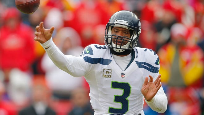 Seattle Seahawks quarterback Russell Wilson (3) throws in the first half of an NFL football game against the Kansas City Chiefs in Kansas City, Mo., Sunday, Nov. 16, 2014.