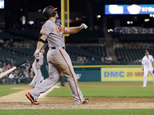 Baltimore Orioles' Chris Davis watches his two-run home run during the 13th inning against the Detroit Tigers, Wednesday, May 17, 2017 in Detroit.
