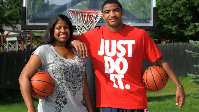Joy Holmes Harris, with her son, Gary Harris, was an All-American at Purdue in the early 1990's.