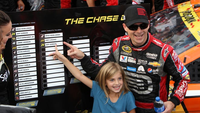 Jeff Gordon and daughter Ella Sofia point to Gordon's name on the Chase grid after his victory in Sunday's AAA 400 at Dover International Speedway.