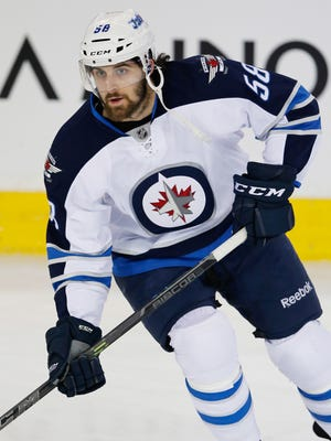 Mar 23, 2015; Edmonton, Alberta, CAN; Winnipeg Jets forward Eric O'Dell (58) skates against the Edmonton Oilers at Rexall Place. Mandatory Credit: Perry Nelson-USA TODAY Sports