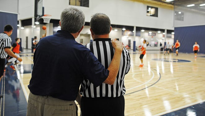 Jared Fredenburg, a licensed SDHSAA official, talks with Buck Timmons, a 2014 SDHSAA Officials Jamboree clinician, during a break while officiating a Summer Jam Basketball League game during the 2014 SDHSAA Officials Jamboree on July 8.