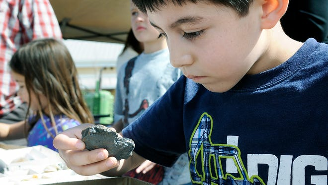 Erick Gomez of Las Cruces, picks out a hematite at a past Museum Rocks! Gem & Mineral Show at the New Mexico Farm & Ranch Heritage Museum. This year's show will be Saturday and Sunday, Feb. 18-19.