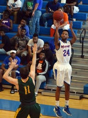 Louisiana College's Kevin Lewis (24, right) shoots