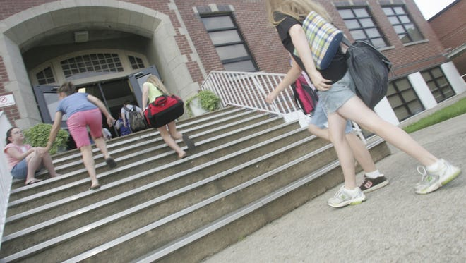 Students walk into McFadden School of Excellence in this 2008 photo.