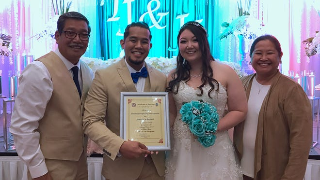San Agustin-Bartnik wedding: Sen. Joe S. San Agustin officiated his son Tomasjoseph San Agustin's wedding to Jaime Jane Bartnik on Oct. 14 at the Hotel Nikko Guam. From left: Sen. San Agustin, TJ San Agustin, Jaime Bartnik and Joanne San Agustin.
