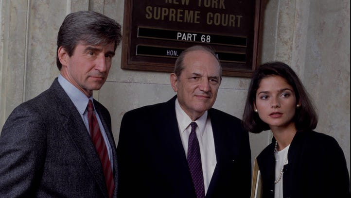 Hill's character, Adam Schiff (center) oversaw two assistant district attorneys,  Michael Moriarty (not pictured) and Sam Waterston, left.