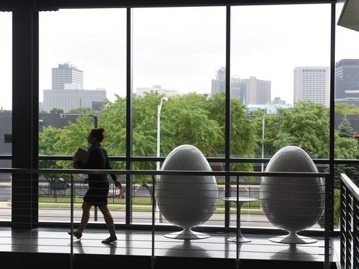 Egg -shaped chairs have a view of Rosa Parks Boulevard