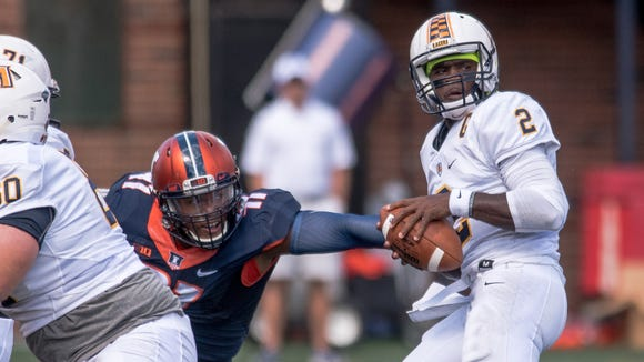 Illinois defensive lineman Chunky Clements (11) pressures Murray State quarterback KD Humphries (2) during the first quarter of an NCAA college football game Saturday, Sept. 3, 2016 at Memorial Stadium in Champaign, Ill.