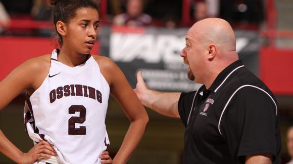 Ossining's Andra Espinoza-Hunter listens to coach Dan Ricci during a break in action against Our Lady of Lourdes in a Class AA girls final of the Section 1 Basketball Championship at the Westchester County Center in White Plains March 3, 2013.