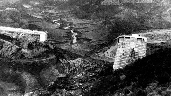 This aerial view shows the broken water barrier of San Francisquito Canyon after the St. Francis Dam burst in 1928.