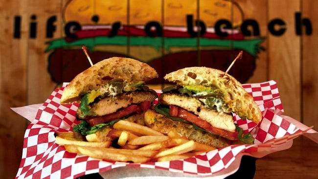 The juicy Grilled Chicken Sandwich from Jack's Beach House, 11240 Montwood, features tangy Monterey Jack cheese, lettuce, tomatoes and avocado.