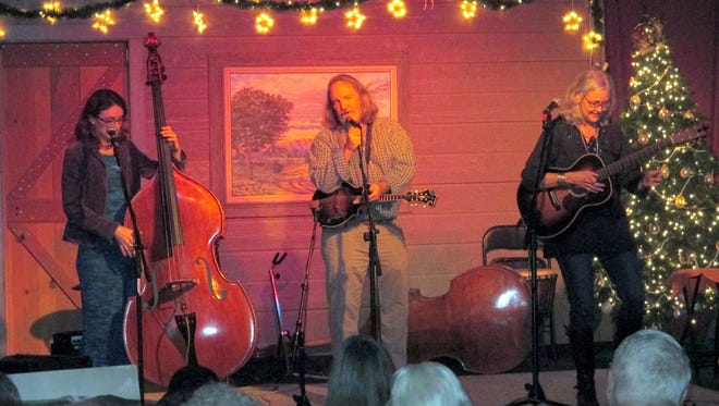 "Steve Smith, Anne Luna and Chris Sanders of the Hard Road Trio perform original southwestern acoustic music ""at the crossroads of roots and bluegrass"" during a recent show at the historic Old Mill."