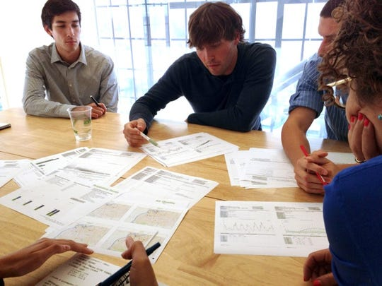Members of the MKThink team brainstorm ideas related to creating the 21st century shotgun house.