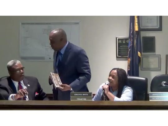 Spring Valley Deputy Mayor Anthony Leon, left, Trustee Emelia White and in back is Mayor Demeza Delhomme at the April 28 meeting.  Video screen grab  by Steve White