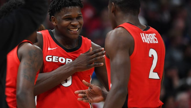 Mar 11, 2020; Nashville, Tennessee, USA; Georgia Bulldogs guard Anthony Edwards (5) and Georgia Bulldogs guard Jordan Harris (2) celebrate after a basket during the second half against the Mississippi Rebels at Bridgestone Arena. Mandatory Credit: Christopher Hanewinckel-USA TODAY Sports