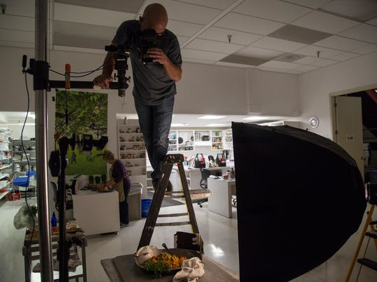 Blaine Moats, staff photographer for Meredith, works on a photo shoot for a new edition of the Better Homes and Gardens New Cook Book on Wednesday, Nov. 29, 2017, at Meredith Corporation's headquarters in downtown Des Moines.