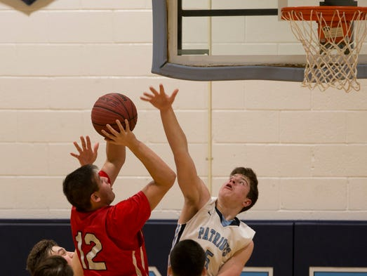 Manalapan's Scott Scherer tries to shoot over the outstretched