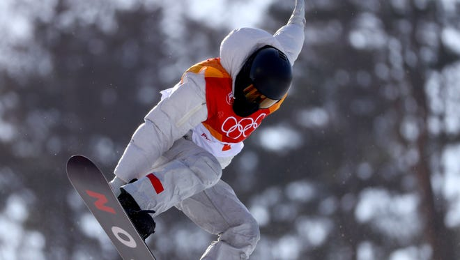 American Shaun White took the top spot in halfpipe qualification.
