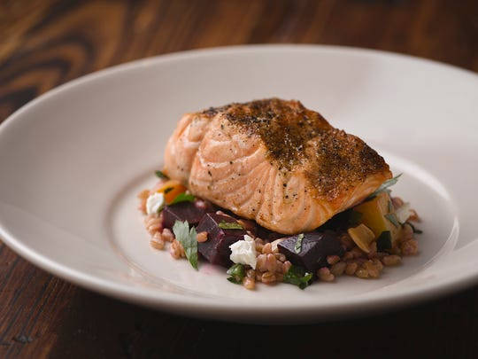 Fire-roasted salmon with roasted beets, goat cheese and farro can be found at Sotto, which was ranked among OpenTable's Top 100 restaurants of 2018.