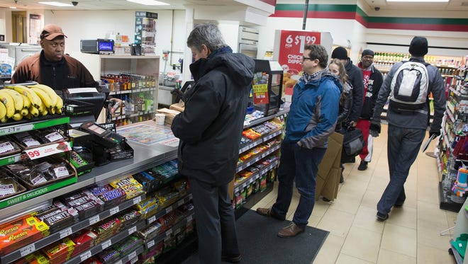 Customers line up to purchase Powerball lottery tickets at a 7-Eleven store on Feb.11, 2015, in Chicago.