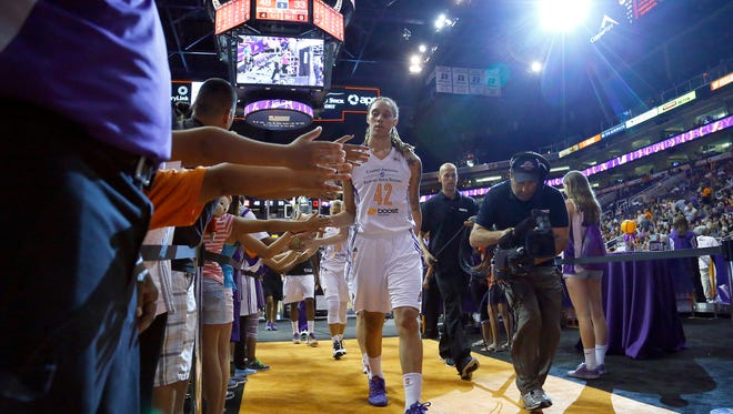 Mercury center Brittney Griner (42) greets fans during half time of their 90-78 win over the Washington Mystics in their WNBA game Tuesday, July 15, 2014 in Phoenix.