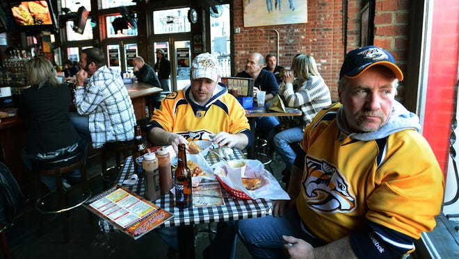Russ Matthews and his son Russell eat at Rippy's before a Preds game, but Titans' fans love it, too.