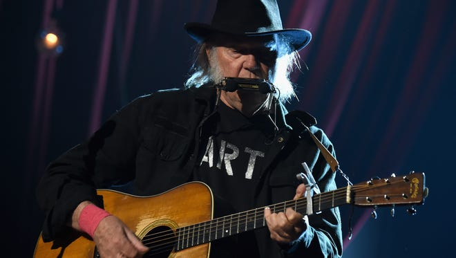 Neil Young performs onstage at the 25th anniversary MusiCares 2015 Person Of The Year Gala honoring Bob Dylan at the Los Angeles Convention Center on February 6, 2015 in Los Angeles, California.