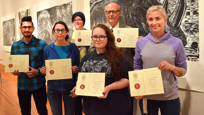 Del Mar College's art program held an induction ceremony Oct. 25 with William Rodriguez (from left), Emily Roberts, Alexander Van Zandt, Andrea Del Angel, Fred Tinsley and Victoria Gibbons forming the inaugural membership of the college's chapter of the Kappa Pi Art Honor Society.