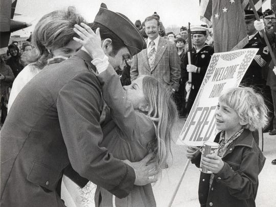 Fred Flom greets his daughter, Julie, 8, and his son, Erik, 6, March 24, 1973, at the Outagamie County Airport. Flom, a Menasha native, had spent more than six years as a prisoner of war in Vietnam.