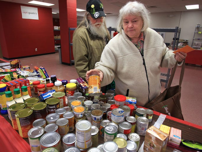 Jeff and Susan Kellams shop at Center Grove Alternative Academy's CARE Food Pantry, Friday, November 22, 2013.  The pantry is open for Johnson County residents in need on Fridays from 12:30 to 2:30.  It is operated by the students.