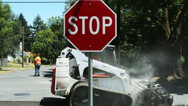 Pavement grinders at work on Rosemont Ave. NW. The city's street maintenance backlog is long.