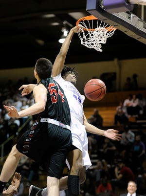 Hardin-Simmons' Nathaniel Jack (45) dunks the ball over LaGrange's Duncan Parker (54) during the first half of the Cowboys' 109-103 win in the first round of the NCAA Div. III men's basketball tournament on Friday, March 3, 2017, at HSU's Mabee Complex.