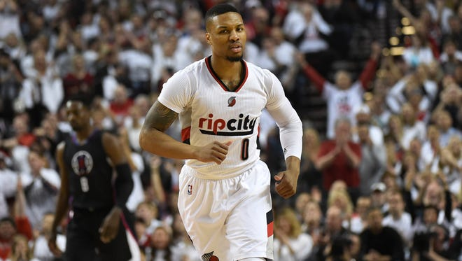 Damian Lillard #0 of the Portland Trail Blazers celebrates after scoring in the first quarter of Game Six of the Western Conference Quarterfinals against the Los Angeles Clippers.