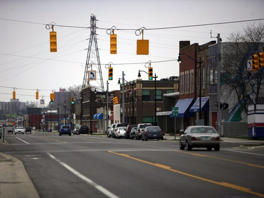 Traffic moves slowly on a street in downtown Benton