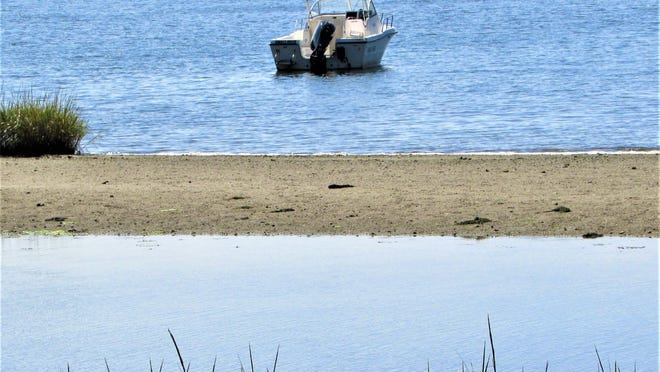The Little Bay channel at Monument Beach will be dredged later this month, but plans for similar work along the Pocasset River have been delayed.    Photo by Paul Gately